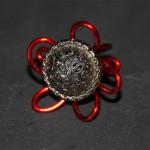 bague rouge bouton métal
