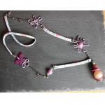 sautoir violet parme et papillon